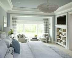 Bedroom with built in bookcase and TV area
