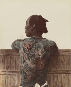 thegetty:  A Japanese man with tattoos, photographed between 1870 and 1890.Hand-colored albumen silver print by Kusakabe Kimbei.