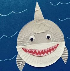 All you need for this fun #shark craft are cupcake liners and #googlyeyes and a blue ocean of course. #SummerArt #PreschoolFun #ToddlerFun #PinterestIdeas #tinyugames #creativekids #craftykids #crafternoon #papercraft #papercrafts #sharky #crafter #toddlerart #invitationtocreate #toddleractivities #toddleractivity #prek #nannylife