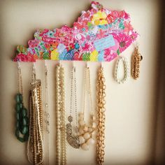 Modge podge a lilly pattern onto a wooden state cutout, and screw in hooks to the bottom to make a cute DIY jewelry hanger!