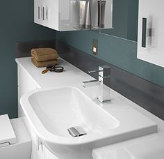 Lucia - The simple, clean lines of our Pavia sanitaryware complement the Lucia bathroom furniture so well.