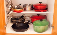 organizing cooking pots and pans