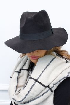 Complete the perfect festival look with this black fedora hat.  ...