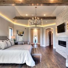 Make sure to enter my giveaway, check out my last post! ✨✨Now how stunning is this bedroom by Starr Homes? Love the stone fireplace and beams!