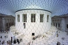 Great Court in The British Museum. Love the space, glass roof, clean symmetry, white walls and floors meeting the old exteriors. It's a great space.