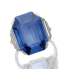 SAPPHIRE AND DIAMOND RING, CARTIER, CIRCA 1930.  Claw-set with a step-cut sapphire, to baguette diamond shoulders, mounted in platinum, size 51, signed Cartier Made in France and numbered, French assay and maker's mark, case.