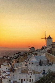 Sunset in Oia Santorini Greece - Is Santorini worth it? Is this Greek island packed with blue buildings, stunning beaches and glorious sunsets that justify the price. The answer in pictures.