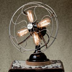 Steam-punk inspired lamp is made from a 1939 Signal Fan | 800.00 from BlinkLabs - http://www.etsy.com/listing/94116126/a-fan-tastic-lamp