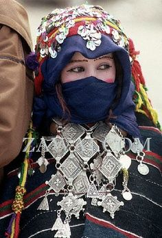 Berber bride wearing silver wealth and talismans of protection and blessings. http://popupsouk.com/jewellery-and-adornment/