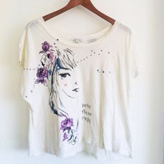 """Forever 21 Cream Off the Shoulder Graphic T-Shirt CONDITION: NWT - new with cut tags  // DESCRIPTION: Forever 21 cream graphic tee shirt, graphic of girl and """"belle fleur rose"""", great to wear off the shoulder with a cute bralette in the spring and summer  // *From non-smoking home // *Currently NOT accepting trades // *Please feel free to leave any questions! THANK YOU! Forever 21 Tops Tees - Short Sleeve"""