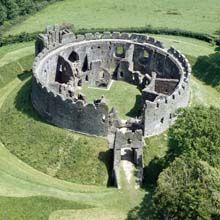 Restormel Castle. The great 13th century circular shell-keep of Restormel still encloses the principal rooms of the castle in remarkably good condition.