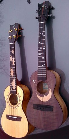 "2 Ukuleles today but they are a matched set ""Sun and Moon"" by Fred Kroner of Leeward Lounge"