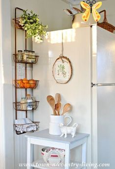 Organize Your Kitchen with a Wall Basket Hanger - Town & Country Living Organize your Kitchen with a Wall Basket Hanger<br> Do you need just a little more space for keeping things orderly in your kitchen? Organize your kitchen with a rustic wall basket hanger! Kitchen Wall Design, Wall Storage Shelves, Kitchen Pantry Storage, Small Bathroom Storage, Kitchen Wall Art, Kitchen Organization, Diy Kitchen, Kitchen Decor, Kitchen Cabinets