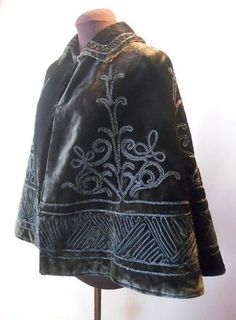 Stunning black velvet Victorian  cape with glass beaded soutache  detailing front and back. Lined in  silk twill with velvet bound inner  pocket.