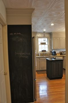 Styrofoam ceiling tiles glue directly to popcorn ceilings. Kitchen by Bella Tucker Decorative Finishes. Also, cabinets built up and crown moulding added. Cabinets painted with chalk paint. Lots of GrEaT ideas in this one that I want to incorporate into our kitchen when we remodel.