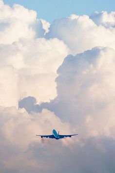 Plane Flying into the Clouds.