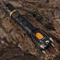 SingFire SF-916 LED 850lm 5-Mode White Flashlight - Black + Golden (1 x 18650). With stainless steel material four-corner attack head, can use as self-defense; A knife at the end of flashlight, which can cut ropes in emergency; With rechargeable charging design; Direct charging design, charging inlet: 3.5 x 1.35mm; Flashlight tailcap with a red POLICE switch,it will buzzing when turn it on.. Tags: #Lights #Lighting #Flashlights #LED #Flashlights #18650 #Flashlights