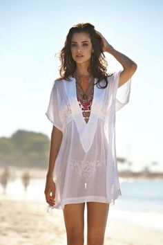 fernanda-prada- oh hello sexy lady! a nice white dress can never go wrong for the beach look !