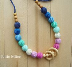 Crochet Nursing necklace Rattle wooden rings Sling by NittoMiton