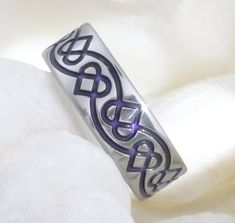 Titanium Irish Celtic Wedding Band - ck35 Purple. $269.00, via Etsy.