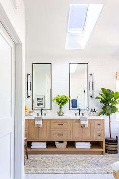 The Secret to a Spa Like Bathroom Renovation | Anita Yokota | On the blog, I am beyond thrilled to be sharing with you the secret combination for the dream bathroom! With these lighting, cabinet, flooring and hardware tips, you'll never need to go to another fancy hotel for a spa bath. #bathroomrenovation #modernhome #lighting #hardware