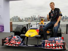 Sebastin Vettel with his Red Bull F1 car at the site of the New Jersey circuit (due to join the calendar in 2013)