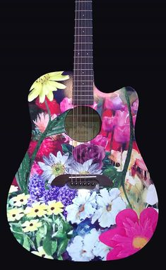 Heather guitar - not sure if this Alvarez is hand painted or this is a decal/photo/print. Anyway it looks rather nice n bright n cheery!