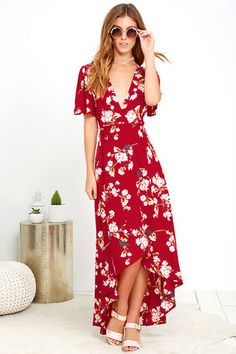 Its name says it all! The Flora Belle Wine Red Floral Print High-Low Wrap Dress is a true beauty with its cream, yellow, teal, and blush pink floral print that covers the fluttering short sleeves, and wrapping bodice with tasseled ties. Woven fabric carries into the high-low skirt.