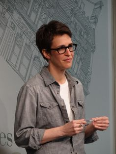 everybody loves rachel maddow... with brains, good humor—and too much showmanship—msnbc's biggest 