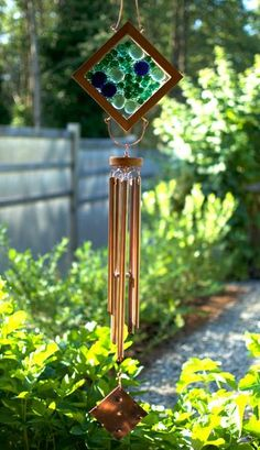 This wind chime measures about 45 inches long from the top of the copper hanger to the bottom of the hammered copper windsail. The artist-made sea glass morsels are loosely trapped between 2 plates of