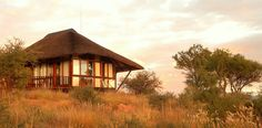 GocheGanas Lodge - A luxurious private nature reserve and wellness village, nestled on a hilltop, surrounded by majestic mountains, boasting with 25 different large wildlife species. Sweeping views onto an awesome Namibian landscape from your luxurious accommodation - 16 private thatched chalets. #GocheGanas #Namibia #Lodge #Accommodation #Wellness #Wildlife #Safari #Conservation