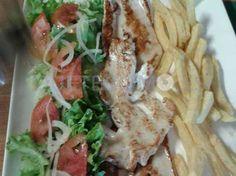Pechuga de pavo con patatas fritas y ensalada | Restaurante asador A Nova Finca en Vigo