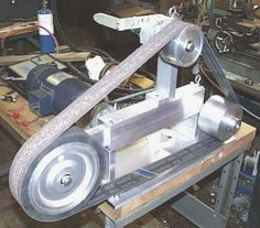 Belt Grinder by Mike Conner -- Homemade belt grinder fabricated from aluminum and driven by a 2 HP electric motor. http://www.homemadetools.net/homemade-belt-grinder-29