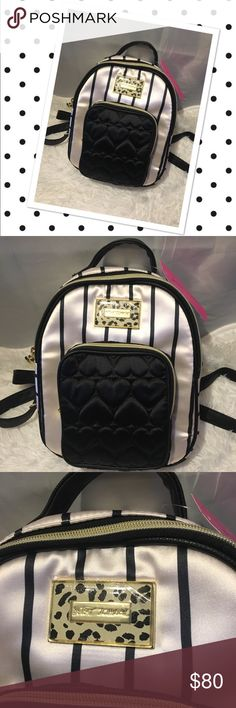 Betsey Johnson Black & white striped backpack Beautiful black & white striped Betsey Johnson Backpack. 100% polyester and lining. Comes from a smoke-free home. Please see my other items - bundle and save! Betsey Johnson Bags Backpacks