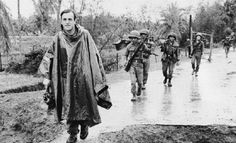 Journalist Peter Arnett walking with a group of South Vietnamese soldiers. ~ Vietnam War