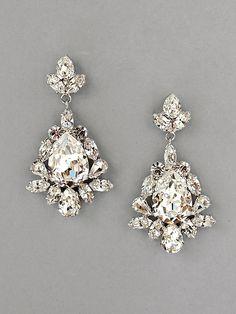 SANDRA EARRINGS: Our crystal, pear-drop-shaped dangle earrings. A charismatic way to enhance every ensemble.