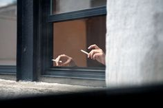 More and more hands just kept appearing out of the window, all with lit cigarettes