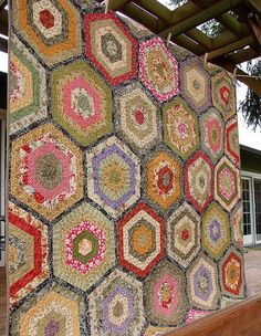 beautiful strippy hexagon quilt scrappy 60 degree triangles