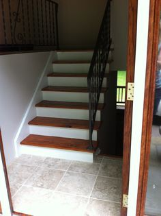 After... The walls painted with Lowes Olympic One Pearl Ash.  Polyshades Miniwax Oecan Gloss on steps and Benjamin Moore white semi gloss on the risers.