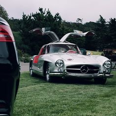 Brand ambassador and legendary British racing driver Sir Sterling Moss paid us a visit at the Star Lounge. He pulled up in none other than this pristine 300 SL that drove in Thursday's Tour d'Elegance.  #MBPhotoPass @bernooo  #pebblebeach #pebblebeach2014 #mercedes #benz #instacar #luxury #germancars #carphotography #carsofinstagram #california #CA #coupe