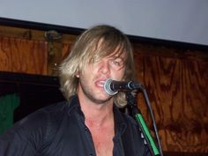 Keith Harkin! He's been with Celtic Thunder since the age of 20. He's now 27. 2013, he began his solo tour around USA and Canada. I took this Apr 3, 2013 in Atlantic Beach, FL at Culhane's Irish Pub. After the concert, he spent time with us. He is an awesome performer! Go get his solo cd: KEITH HARKIN