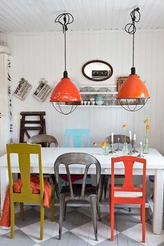love mismatched chairs and ORANGE :)