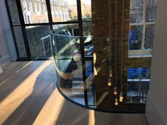 Curved balcony with frameless glass balustrade