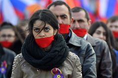 People wear gags in central Moscow on April 24, 2015, to mark the 100th anniversary of the Armenian genocide.