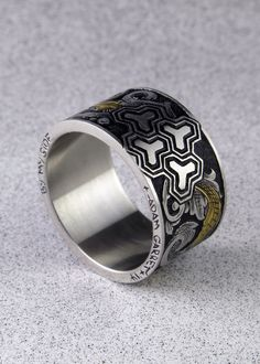 Engraved stainless steel ring with 24k inlay.
