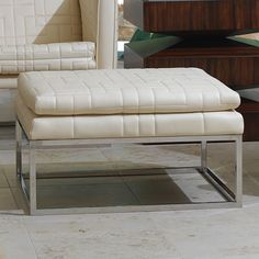 Quilted cowhide leather ottoman with a polished stainless steel base #ottoman #chair #furniture