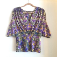 Anthropologie Fei Geo Feather Blouse Fun flowy top that cinches into the top of the waist with zipper close. Pairs great with jeans or your favorite pair of skinny pants. Worn a few times, well taken care of and looks like new. Anthropologie Tops Blouses