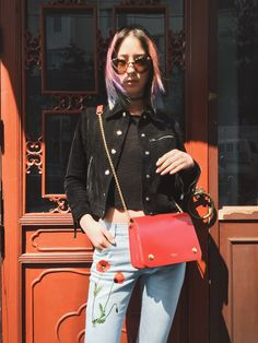 Irene Kim with the Clifton in Scarlet Crossboarded Calf. A practical cross body bag that can be worn across the body or over the shoulder.