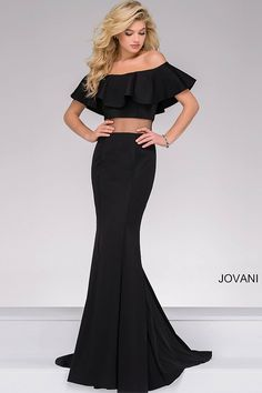 Elegant black floor length form fitting jersey off the shoulder dress features ruffle top and an illusion waist.