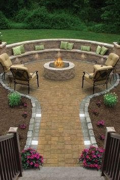 Traditional Patio with exterior stone floors, Built-in bench seating, Curved outdoor bench, Pathway, exterior brick floors